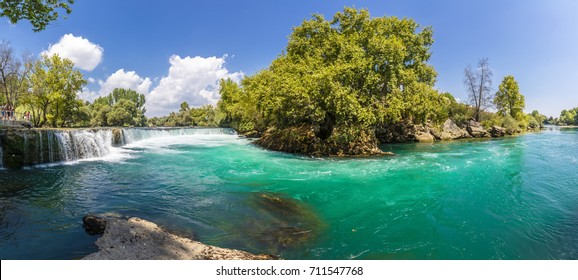 Manavgat, Turkey - September 06, 2017 : People are visiting Manavgar Waterfall in Antalya. Manavgat is populer tourist attraction in Turkey.
