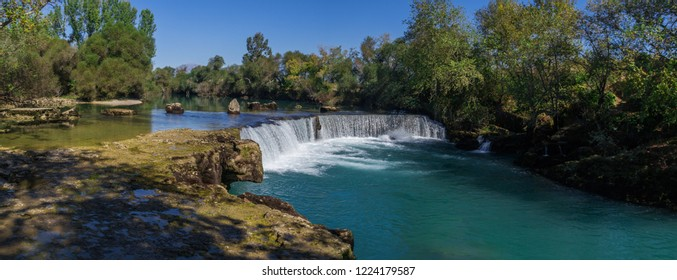 Manavgat Waterfall in Turkey. Famous natural landmark near Antalya, Alanya, Side, Kemer. Panoramic view. panorama.