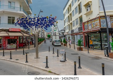 """Manavgat,Antalya/Turkey-06.14.2019-Art nouveau tree made of stainless steel and decorated with glass pebbles instead of leaves, in the form of an amulet called """"The Eye of Evil"""" or """"nazar boncugu"""""""