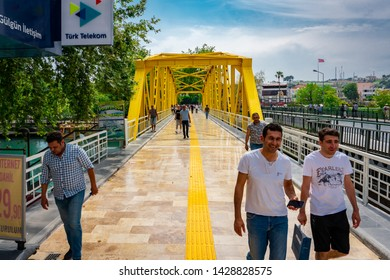 Manavgat,Antalya/Turkey-06.14.2019-The famous and wonderful bridge over the Manavgat river, newly consolidated crossed by pedestrians on the run because the rain is coming