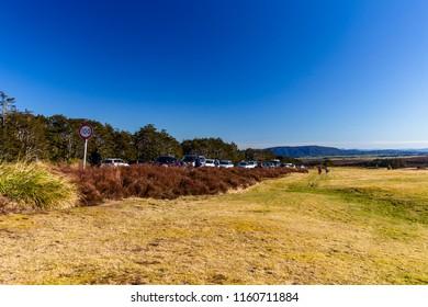 Manawatu-Wanganui, New Zealand, August 11, 2018: Skiiers parking next to The Chateau in Whakapapa Village, New Zealand.