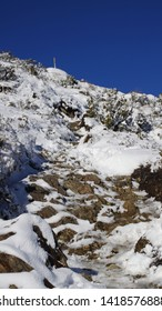 Manawatu-Wanganui, New Zealand - June 3rd 2019.  Tramping to the upper section of the Mt Urchin Track in early winter, when the track covered in snow.