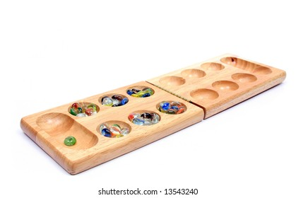 Mancala is a family of board games played around the world, also called sowing games or count and capture games.
