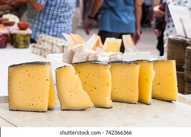 Manchego cheese for sale in the stall of Sineu market, Majorca, Spain