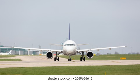 MANCHESTER AIRPORT - APRIL 15th 2018: Front view of Lufthansa A319-100 preparing to take off at Manchester Airport, UK APRIL 15th, 2018