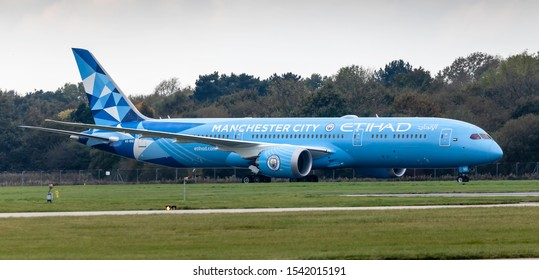 Manchester Airport, England, 23rd October 2019, Etihad Airways passenger aircraft, A6-BND a Boeing 787 – 9 in Manchester City Football Club colours livery taxis to its stand at the airport.