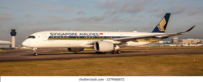 Manchester Airport, England, 3rd December 2019, Singapore Airlines passenger aircraft, 9V-SMK an Airbus A350 – 941XWB gets ready for take-off from airport.