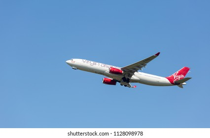 MANCHESTER AIRPORT - JULY 4th 2018: Virgin Atlantic Airbus A330-300 soon after taking off at Manchester Airport, UK JULY 4th, 2018
