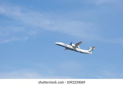 MANCHESTER AIRPORT - MAY 15th 2018: Flybe Bombardier Dash 8 Q400 soon after take off at Manchester Airport, UK MAY 15th, 2018