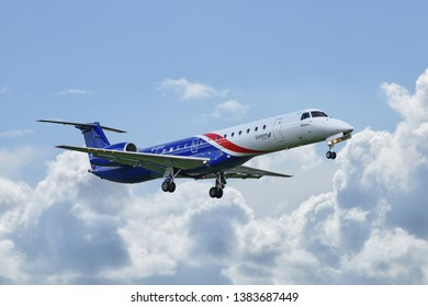 Manchester Airport, United Kingdom - April 2, 2019: Eastern Airways G-CIYX Embraer ERJ-145 moments before touchdown.