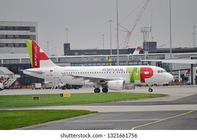 Manchester Airport, United Kingdom - November 9, 2018: TAP Air Portugal CS-TTG Airbus A319-111 MSN 906 ex D-AVYN taxiing in overcast weather.