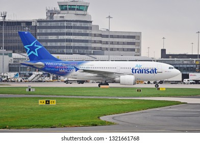 Manchester Airport, United Kingdom - November 9, 2018: Air Transat C-GSAT Airbus A310 - MSN 600 ex 5Y-KQM A6-EKH taxiing in overcast weather.