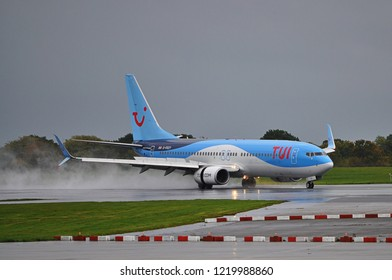 Manchester Airport, United Kingdom - October 12, 2018: TUI Airways Boeing 737-8K5(WL) G-FDZY landing in stormy weather.