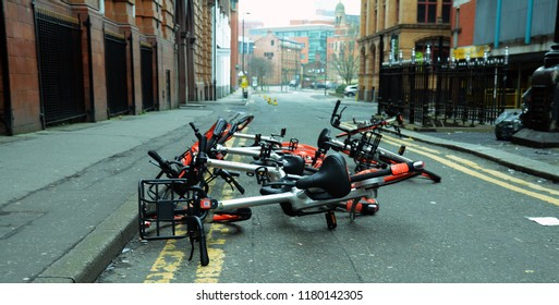 Manchester city centre, UK, April 8th 2018, a photo of a group of mobike cycles dumped in the street