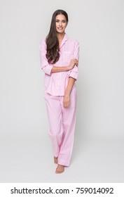 manchester, England, 05/07/2016, A beautiful tall brunette girl in a pink pyjama dress, night wear, evening sleep wear.