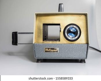 Manchester, England, 12/11/19 Halina  HalinaMat Slide Projector for 35mm film photographs photo slides Vintage retro photography equipment shot in studio on white background isolated. Grey projekter