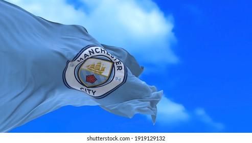 Manchester , England - 17 February 2021 - Waving flag of English football club Manchester City F.C.