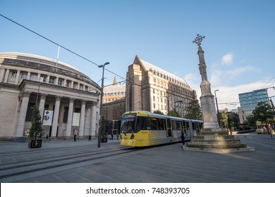 Manchester, England - 5 October 2017 : View of Manchester Town Hall and Manchester Central Library, with tram on the foreground