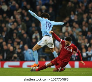 MANCHESTER, ENGLAND - APRIL 10: Alex Oxlade-Chamberlain   tackles Leroy Sane  during the Champions League quarter final match between Manchester City and Liverpool  on April 10, 2018