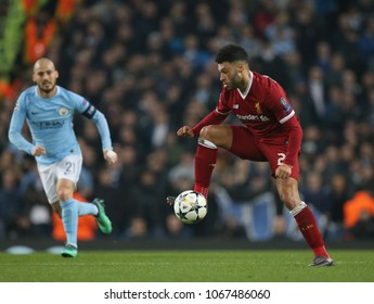 MANCHESTER, ENGLAND - APRIL 10: David Silva  and Alex Oxlade-Chamberlain  during the Champions League quarter final match between Manchester City and Liverpool at the Etihad Stadium on April 10, 2018