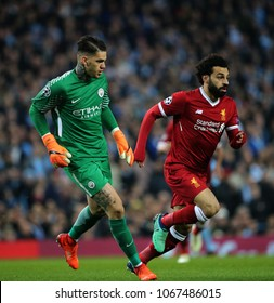 MANCHESTER, ENGLAND - APRIL 10:  Ederson  and Mohamed Salah  during the Champions League quarter final match between Manchester City and Liverpool at the Etihad Stadium on April 10, 2018