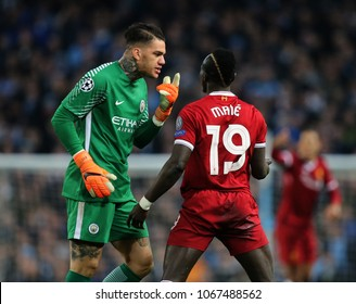 MANCHESTER, ENGLAND - APRIL 10: Ederson  and Sadio Mane  during the Champions League quarter final match between Manchester City and Liverpool at the Etihad Stadium on April 10, 2018