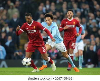 MANCHESTER, ENGLAND - APRIL 10: Georginio Wijnaldum   and Leroy Sane  during the Champions League quarter final match between Manchester City and Liverpool at the Etihad Stadium on April 10, 2018
