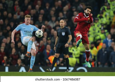 MANCHESTER, ENGLAND - APRIL 10: Kevin De Bruyne  and Mohamed Salah  during the Champions League quarter final match between Manchester City and Liverpool at the Etihad Stadium on April 10, 2018