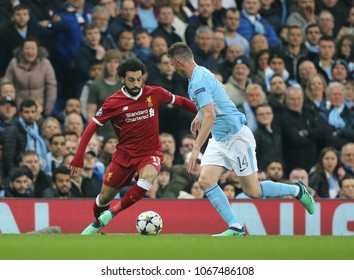 MANCHESTER, ENGLAND - APRIL 10: Mohamed Salah  runs at Aymeric Laporte  during the Champions League quarter final match between Manchester City and Liverpool at the Etihad Stadium on April 10, 2018