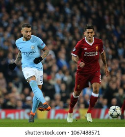 MANCHESTER, ENGLAND - APRIL 10: Nicolas Otamendi  and Roberto Firmino  during the Champions League quarter final match between Manchester City and Liverpool at the Etihad Stadium on April 10, 2018