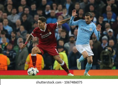 MANCHESTER, ENGLAND - APRIL 10: Roberto Firmino   and Bernardo Silva  during the Champions League quarter final match between Manchester City and Liverpool at the Etihad Stadium on April 10, 2018
