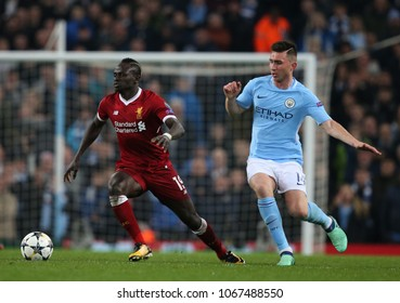 MANCHESTER, ENGLAND - APRIL 10: Sadio Mane   and Aymeric Laporte  during the Champions League quarter final match between Manchester City and Liverpool at the Etihad Stadium on April 10, 2018