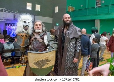 MANCHESTER, ENGLAND - APRIL 14, 2019: Ned Stark Cosplayer and Unidentified Cosplayer pose at the Manchester Anime and Gaming Convention
