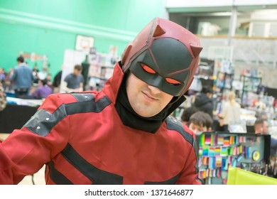 MANCHESTER, ENGLAND - APRIL 14, 2019: Daredevil Cosplayer poses at the Manchester Anime and Gaming Convention