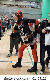 MANCHESTER, ENGLAND - APRIL 2, 2016: Deadpool Cosplayer poses at the Manchester Anime and Gaming Convention