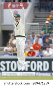 MANCHESTER, ENGLAND - August 04 2013: Michael Clarke jumps into the air celebrating the wicket of Stuart Broad during day four of  the Investec Ashes 4th test match at Old Trafford Cricket Ground