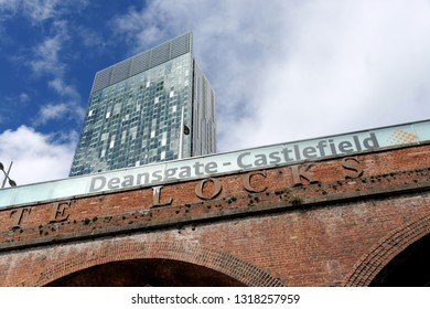 MANCHESTER, ENGLAND - AUGUST 10, 2018: Beetham Tower, aka Hilton Tower, seen from Deansgate on Rochdale Canal Towpath.