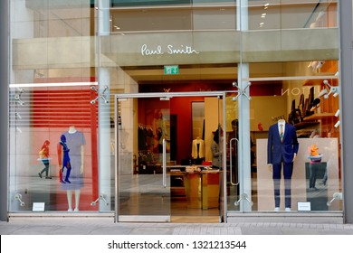 MANCHESTER, ENGLAND - AUGUST 10, 2018: The shop window of the Paul Smith store. It sells designer men's and women's clothing, shoes & accessories.