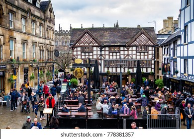 MANCHESTER, ENGLAND - DECEMBER 3, 2017: People having lunch at The Old Wellington pub on Shambles Square, United Kingdom