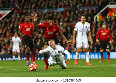 MANCHESTER, ENGLAND - FEBRUARY 12 2019: Marcus Rashford of Manchester United fouls Marco Verratti of PSG  during the Champions League match between Manchester United and Paris Saint-Germain