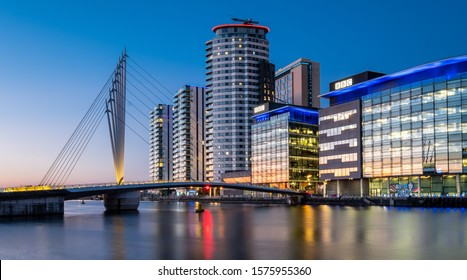 MANCHESTER, ENGLAND - November 30th, 2019 - Salford Quays Media City, Manchester. Looking across the pedestrian footbridge to the BBC studios building.