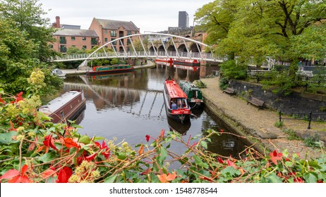 MANCHESTER, ENGLAND - OCTOBER 22, 2019: A lovely scenery of Castlefield. UK's first urban heritage park. Castlefield is a walkable area filled with canals, casual waterfront bars and green spaces.