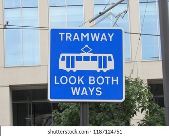 Manchester, England: Sept 2018 - A blue and white tramway sign with Look both Ways information