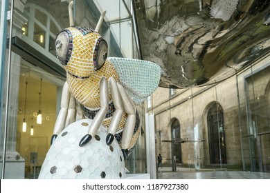 MANCHESTER, ENGLAND -September 19., 2018:,  - Bee in the City, The Manchester Bee sculptures. Bee at  in Manchester, St Peter's Square at entrance in Menchester central library.