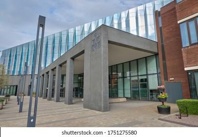 Manchester, England, UK - 04/19/2020: A Manchester Metropolitan University business school building, Manchester, England, UK.