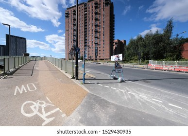 Manchester, England, UK - 09/17/2019: Main road, with cycle lane and road works, into Manchester (UK).
