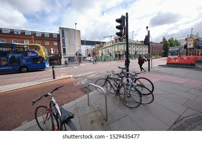 Manchester, England, UK - 10/09/2019: All Saints/Manchester (UK), near Manchester Metropolitan University, a main road junction on Oxford road, showing traffic, cyclist, cycle lane and cycle stand.