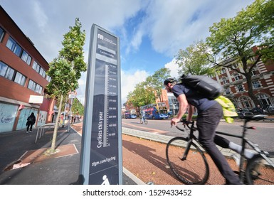 Manchester, England, UK - 10/09/2019: Cyclist(s) on cycle lane and road into Manchester (UK) with digital cycle counter display, Oxford road, Rusholme, Manchester (UK)