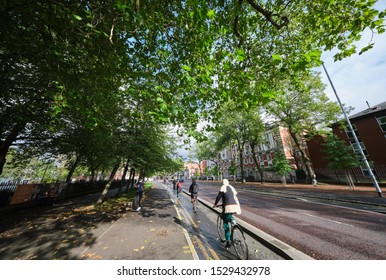 Manchester, England, UK - 10/09/2019: University students using cycle lane, opposite St. Marys hospital (NHS) buildings, Oxford road Manchester (UK)