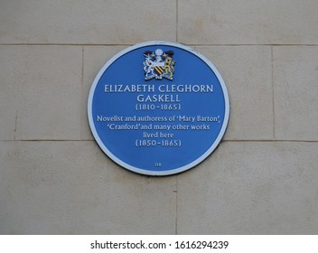 Manchester, England, UK.  January 13, 2020. A blue plaque commemorating the life of Elizabeth Gaskell, an English novelist.